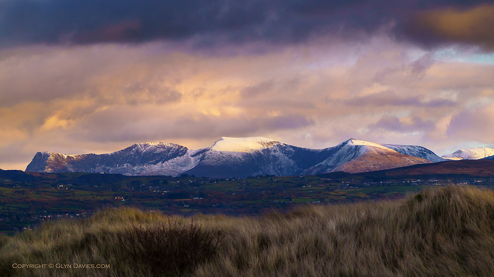Normally I avoid taking pictures of the mountains when they only have light patchy snow, as I always think it looks 'messy' but this evening, in the last of the sunlight before dusk, there was something subtly beautiful about it all, so I relented and made an image before a very muddy, squelchy, flooded walk home.
