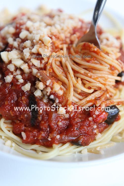 a plate of Spaghetti and marinara sauce