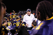 Milpitas High School head coach Kelly King leads a post-game speech and prayer after beating Sacred Heart Cathedral 28-21 at Milpitas High School in Milpitas, California, on September 20, 2013. (Stan Olszewski/SOSKIphoto)