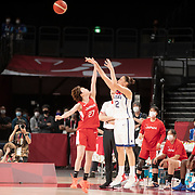 TOKYO, JAPAN August 8:  Diana Taurasi #12 of the United States shoots for three while defended by Saki Hayashi #27 of Japan during the Japan V USA basketball final for women at the Saitama Super Arena during the Tokyo 2020 Summer Olympic Games on August 8, 2021 in Tokyo, Japan. (Photo by Tim Clayton/Corbis via Getty Images)