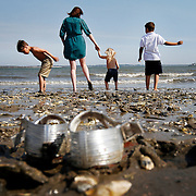 Lekeisha Gerike, of Beaufort, accompanies Jace Paulk, 6, Jamison Paulk, 3, and Jaxen Porter, 8, while exploring The Sands in Port Royal on April 2, 2014.