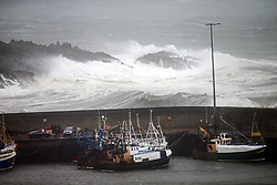 © London News Pictures. 16/10/2017. High winds and rough seas smash into the County Down harbour of Ardglass as the remnants of Ophelia hit Northern Ireland, Monday 16, Oct 2017. An amber warning for Northern Ireland, Wales, south west Scotland and the Isle of Man is in force until 23:00 BST. Photo credit: Paul McErlane/LNP