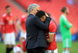 Manchester United manager Jose Mourinho embraces Jesse Lingard after the game