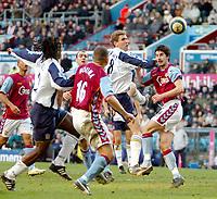 Photo: Ed Godden.<br />Aston Villa v Portsmouth. The Barclays Premiership. 04/03/2006. <br />Portsmouth players scramble for the ball in the Villa area.