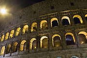The Colosseum at night, also known as the Flavian Amphitheatre, is an oval amphitheatre in the centre of the city of Rome, Italy
