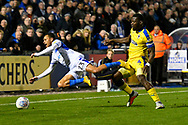 Kyle Bennett (23) of Bristol Rovers is fouled by Deji Oshilaja (4) of AFC Wimbledon during the EFL Sky Bet League 1 match between Bristol Rovers and AFC Wimbledon at the Memorial Stadium, Bristol, England on 23 October 2018.
