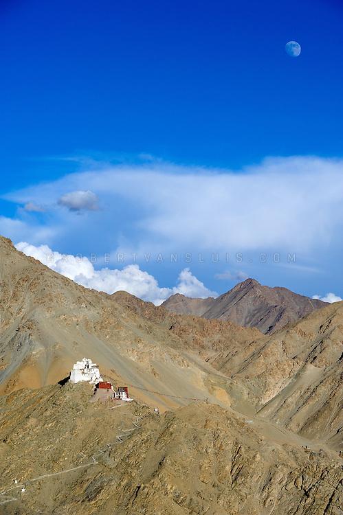 Last rays of sunlight illuminate the mountains and Namgyal Tsemo Monastery, Leh, Ladakh, India