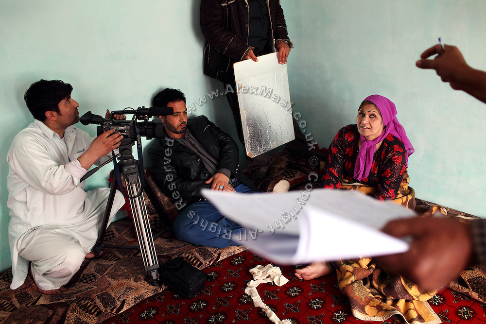 Yasamin Yarmal, 42, (right) a famous Afghan actress taking part to 'Love and Old Age', a successful soap opera broadcasted by Ariana Television Network (ATN), is discussing her acting with Ghafar Zalam, 48, (right - hands and script visible) the director, inside a home on the outskirts of Kabul, Afghanistan. Yasamin Yarmal has performed in over 100 movies and some refer to her as the 'mother' of Afghan cinema. She was also selected as UNAMA (United Nation Assistance Mission in Afghanistan) Peace Ambassador in 2009 for her role in leading a change towards women within the conservative and patriarchal Afghan society.