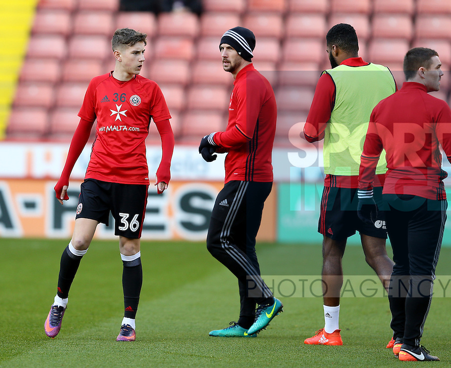 David Brooks of Sheffield Utd and Jake Wright of Sheffield Utd  during the English League One match at Bramall Lane Stadium, Sheffield. Picture date: December 26th, 2016. Pic Simon Bellis/Sportimage