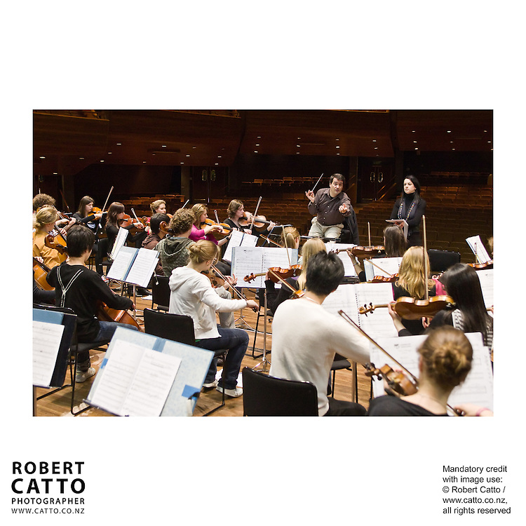 The New Zealand National Youth Orchestra rehearse for a concert with soloist Madeleine Pierard and conductor Jacques Lacombe, at the Michael Fowler Centre in Wellington...Programme: .RAVEL Alborada del Gracioso.ROUSSEL Bacchus et Ariane Suite No 2.CANTELOUBE Chants DÕAuvergne.TABEA SQUIRE Feverdream (World Premiere).STRAVINSKY The Firebird Suite (1945)