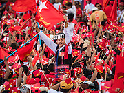 01 NOVEMBER 2015 - YANGON, MYANMAR:  A man in traditional ethnic dress waves the NLD banner at the NLD's last election rally of the 2015  election in the Yangon suburbs Sunday. Political parties are wrapping up their campaigns in Myanmar (Burma). National elections are scheduled for Sunday Nov. 8. The two principal parties are the National League for Democracy (NLD), the party of democracy icon and Nobel Peace Prize winner Aung San Suu Kyi, and the ruling Union Solidarity and Development Party (USDP), led by incumbent President Thein Sein. There are more than 30 parties campaigning for national and local offices.    PHOTO BY JACK KURTZ