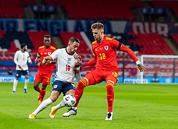LONDON, ENGLAND - Thursday, October 8, 2020: England's Danny Ings is blocked by Wales' Joe Rodon during the International Friendly match between England and Wales at Wembley Stadium. The game was played behind closed doors due to the UK Government's social distancing laws prohibiting supporters from attending events inside stadiums as a result of the Coronavirus Pandemic. England won 3-0. (Pic by David Rawcliffe/Propaganda)
