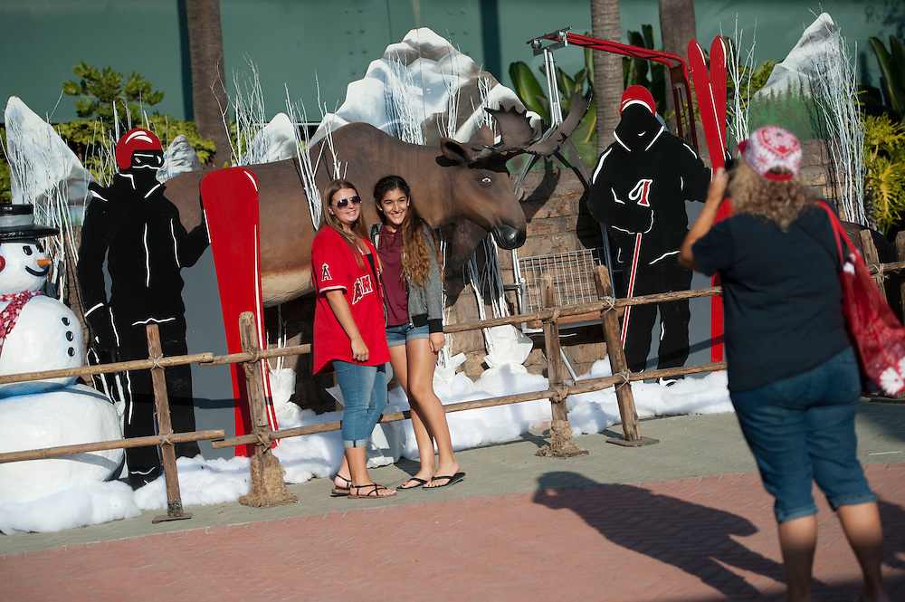 Angel fans pose with a diorama during the Angels' Christmas in June promotion Friday at Angel Stadium.<br /> <br /> ///ADDITIONAL INFO:   <br /> <br /> angels.0625.kjs  ---  Photo by KEVIN SULLIVAN / Orange County Register  --  6/24/16<br /> <br /> The Los Angeles Angels take on the Oakland Athletics Friday at Angel Stadium.<br /> <br /> <br />  6/24/16
