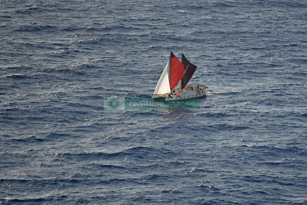 June 16, 2017 - Oahu, HI, United States of America - The Polynesian double-hulled voyaging canoe, Hokule'a, approaches Oahu after sailing 40,000 nautical miles around the world during a 36-month journey in Hawaii. The Hokulea is a full-scale replica of an ancient Polynesian double-hulled voyaging canoe built to prove the theory that Polynesian people traveled great distances by boat throughout history. (Credit Image: © Tara Molle/Planet Pix via ZUMA Wire)