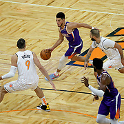 ORLANDO, FL - MARCH 24: Devin Booker #1 of the Phoenix Suns dribbles the ball in front of Nikola Vucevic #9 of the Orlando Magic and Evan Fournier #10 of the Orlando Magic at Amway Center on March 24, 2021 in Orlando, Florida. NOTE TO USER: User expressly acknowledges and agrees that, by downloading and or using this photograph, User is consenting to the terms and conditions of the Getty Images License Agreement. (Photo by Alex Menendez/Getty Images)*** Local Caption *** Devin Booker; Nikola Vucevic; Evan Fournier