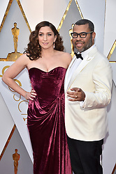 Actress Chelsea Peretti (L) and director Jordan Peele walking the red carpet as arriving for the 90th annual Academy Awards (Oscars) held at the Dolby Theatre in Los Angeles, CA, USA, on March 4, 2018. Photo by Lionel Hahn/ABACAPRESS.COM