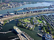 Nederland, Noord-Holland, Gemeente Amsterdam; 02-09-2020;  Oosterdok en Kattenburg,  Marineterrein (Marine Etablissement Amsterdam) en Scheepvaartmuseum. In het water van het Oosterdok de ingang van IJtunnel, met  Nemo Science Museum. Piet Heinkade.<br /> Eastern Dock with new hotspot former Navy yard. Tunnel entrance with Nemo Science Museum.<br /> luchtfoto (toeslag op standaard tarieven);<br /> aerial photo (additional fee required)<br /> copyright © 2020 foto/photo Siebe Swart