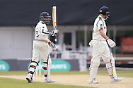Yorkshire All-rounder Adil Rashid celebrates his 50 half century during the Specsavers County Champ Div 1 match between Yorkshire County Cricket Club and Surrey County Cricket Club at Headingley Stadium, Headingley, United Kingdom on 10 May 2016. Photo by Simon Davies.