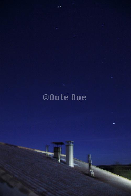 night sky with chimneys