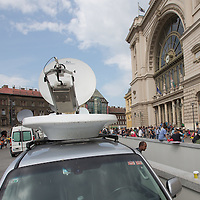 TV broadcast vans stand in front of the main railway station Keleti where illegal migrants gather in the transit zones in the hopes to leave for Germany in Budapest, Hungary on September 03, 2015. ATTILA VOLGYI