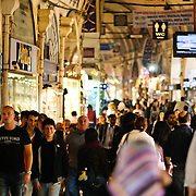 A busy central street of Istanbul's historic Grand Bazaar, all of which is indoors.