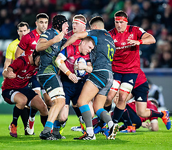 Shane Daly of Munster  under pressure from Tiaan Thomas-Wheeler of Ospreys<br /> <br /> Photographer Simon King/Replay Images<br /> <br /> European Rugby Champions Cup Round 1 - Ospreys v Munster - Saturday 16th November 2019 - Liberty Stadium - Swansea<br /> <br /> World Copyright © Replay Images . All rights reserved. info@replayimages.co.uk - http://replayimages.co.uk