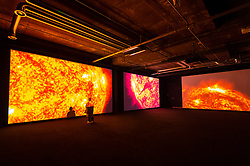 """© Licensed to London News Pictures. 17/05/2021. LONDON, UK. """"data-verse I, II and III"""", 2019, 2020, by Roji Ikeda. Preview of Ryoki Ikeda's exhibition at 180 The Strand, the largest ever European exhibition of the Japanese artist's work.  Twelve audio-visual digital artworks, five of which have never been seen before, are on show 20 May to 1 August 2021.  Photo credit: Stephen Chung/LNP"""
