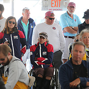 Skipper Sarah Everhart Skeels, (center), Tiverton, RI, and Cindy Walker, (left), Middletown, RI, the only all female team competing in The Skud 18 class, at team briefing before the C. Thomas Clagett, Jr. Memorial Clinic & Regatta at Newport, Rhode Island hosted by Sail Newport at Fort Adams. <br /> The Clagett is North America's premier event for sailors with disabilities with sailors competing in the 3 Paralympic class boats and is an integral part of preparation for athletes preparing for  Paralympic and world championship racing. Newport, Rhode Island, USA. 26th June 2015. Photo Tim Clayton