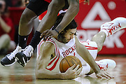 Jan 26, 2011; Houston, TX, USA; Houston Rockets power forward Luis Scola (4) dives for a loose ball against the Los Angeles Clippers during the first quarter at the Toyota Center. Mandatory Credit: Thomas Campbell-US Presswire