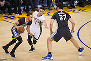 Brooklyn Nets guard Jeremy Lin (7) tries to get past a screen from Golden State Warriors center Zaza Pachulia (27) while guarding guard Stephen Curry (30) at Oracle Arena in Oakland, Calif., on February 25, 2017. (Stan Olszewski/Special to S.F. Examiner)