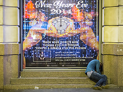 © Licensed to London News Pictures . 01/01/2015 . Manchester , UK . A man , ejected from Tiger Tiger, slumps on steps . He is missing special guest Danny Dyer . Revellers usher in the New Year on a night out in Manchester City Centre .  Photo credit : Joel Goodman/LNP