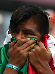 A Mexico fan appears dejected after the team in knocked out