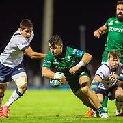 GALWAY, IRELAND:  October 01:   Tiernan O'Halloran #15 of Connacht gets the ball away as Harold Vorster #12 of Vodacom Bulls moves in to tackle during the Connacht V Vodacom Bulls, United Rugby Championship match at The Sportsground on October 1st, 2021 in Galway, Ireland. (Photo by Tim Clayton/Corbis via Getty Images)