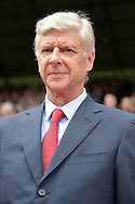 Arsene Wenger, the Arsenal manager looks on as he arrives at the dugout before k/o. Barclays Premier league match, Crystal Palace v Arsenal at  Selhurst Park in London on Sunday 16th August 2015.<br /> pic by John Patrick Fletcher, Andrew Orchard sports photography.