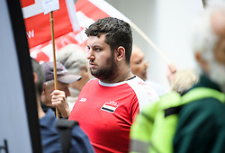 © Licensed to London News Pictures. 04/09/2018. London, UK. A man wearing a Syrian football shirt joins pro Jeremy Corbyn protestors outside Labour Party headquarters in London ahead of a National Executive Committee meeting. The Labour Party's ruling body is expected to vote on whether to adopt, in full, the IHRA (International Holocaust Remembrance Alliance) definition of anti-Semitism. Photo credit: Ben Cawthra/LNP