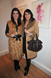 Left to right, EMILY CORCORAN and CORINNE KEMPA at a party to launch Alistair Taylor-Young's new book 'The Phone Book' held at The Little Black Gallery, 13A Park Walk, London SW10 on 18th January 2011.