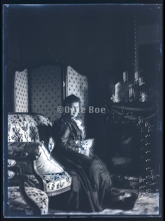 adult woman sitting on a bench indoors France ca 1920s