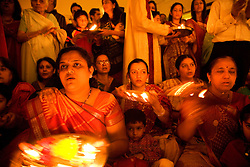Women worshipping by candlelight in celebration of Navratri; the Hindu festival of Nine Nights,