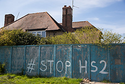 Stop HS2 graffiti is pictured outside a property boarded up in preparation for works associated with the HS2 high-speed rail link on 26th April 2021 in Calvert, United Kingdom. Calvert has been particularly badly impacted by HS2 infrastructure project work because of its position close to the intersection between HS2 and East West Rail.