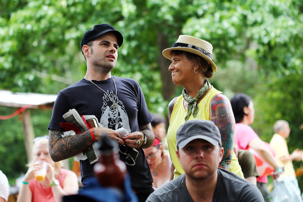 Jay Bakker, left, converses with festival participants at the Wild Goose Festival at Shakori Hills in North Carolina June 25, 2011.  (Photo by Courtney Perry)