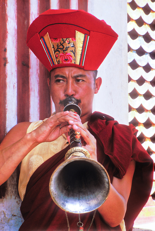 A Buddhist monk blows a Tibetan-style horn in a ceremony at Swyambhunath (aka The Monkey Temple) atop a hill overlooking Nepal's Kathmandu Valley. The music the monks played sounded like jazz saxophonist John Coltrane in his last, cosmic, high energy period.