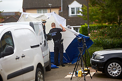 © Licensed to London News Pictures. 20/10/2019. Milton Keynes, UK. Police officers erect a forensic tent at the scene in Archford Croft in Emerson Valley where two 17 year old boys were stabbed to death overnight. Two adult males where also injured. Thames Valley Police have begun a double murder investigation but have yet to make any arrests.  Photo credit: Cliff Hide/LNP