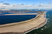 Nederland, Zuid-Holland, Rotterdam,  15-07-2012; Aanleg Maasvlakte 2. Contouren van de nieuwe havenbassins en kades, gezien naar het depot van De Slufter. Onder in beeld de zogenaamde zachte zeewering bestaande uit opgespoten duinen beplant met helm. Expansion of the Port of Rotterdam, the second Maasvlakte. The contours of the new harbor basins with quays and the so-called soft seawall, artificial dunes with haram grass..luchtfoto (toeslag); aerial photo (additional fee required); .foto Siebe Swart / photo Siebe Swart