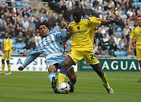 Photo: Ian Hebden.<br /> Coventry City v Cardiff City. Coca Cola Championship. 30/04/2006.<br /> Coventrys Richard Shaw (L) tackles Cardiffs Guylain Ndumbu-Nsungu (R).