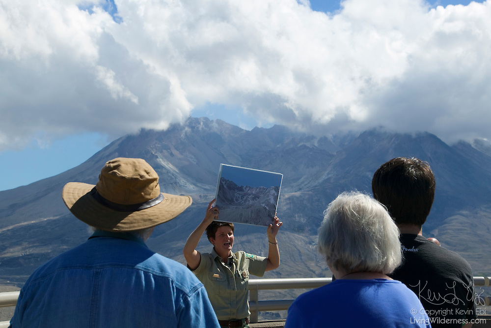 A ranger talks to visitors at the Johnston Ridge Observatory about the dome-building activity in the crater of Mount St. Helens, Washington.