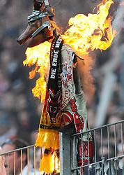 05.03.2011, Commerzbank-Arena, Frankfurt, GER, 1. FBL, Eintracht Frankfurt vs 1.FC Kaiserslautern, im Bild Frankfurter Anhaenger zuenden einen Schweinskopf mit den Symbolen des 1.FCK an, EXPA Pictures © 2011, PhotoCredit: EXPA/ nph/  Roth       ****** out of GER / SWE / CRO  / BEL ******