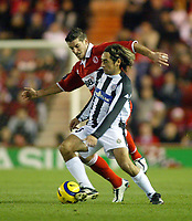 15/12/2004 - UEFA Cup, Group E - Middlesbrough v FK Partizan - The Riverside, Middlesbrough<br />Middlesbrough's Franck Queudrue shadows and out-muscles FK Partizan Belgrade's Dragan Ciric<br />Photo:Jed Leicester/Back Page Images