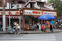 street scene in shanghai china with local food shops