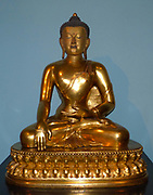 Seated Buddha 1740-86, China, Gilded copper.  The Buddha is shown just before his enlightenment when he lowers his right hand to the ground to call the earth goddess to witness his worthiness to attain liberation.