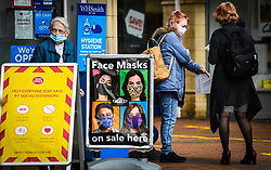 © Licensed to London News Pictures. 08/09/2020. Caerphilly, Wales, UK. People wear masks in the town of Caerphilly in south Wales, which has gone into lockdown along with it's wider borough area, after what is being described as a rapid increase in coronavirus cases. The Welsh government announced that from 6pm on Tuesday people will not be able to leave or enter the area without good reason, along with other restrictive measures.<br />  Photo credit: Robert Melen/LNP